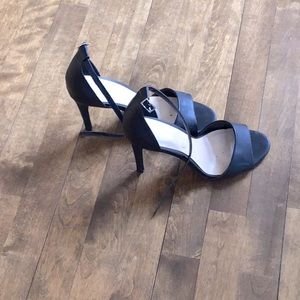 Black open toe sandals in the front Le Chateau
